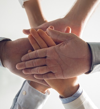 Close-up of stacked hands of business team, low angle view, success and teamwork concept